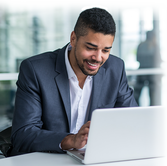 Black man typing on keyboard of a laptop computer