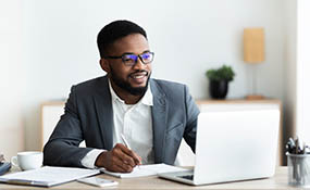 Black male working at computer