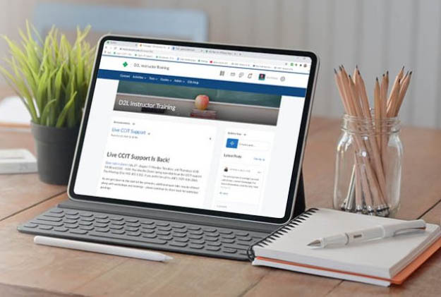 Laptop with on-line course on the screen